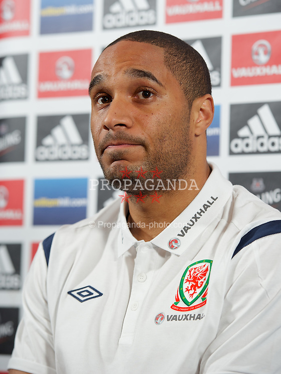 GLASGOW, SCOTLAND - Thursday, March 21, 2013: Wales' captain Ashley Williams during a press conference at Hampden Park ahead of the 2014 FIFA World Cup Brazil Qualifying Group A match against Scotland. (Pic by David Rawcliffe/Propaganda)