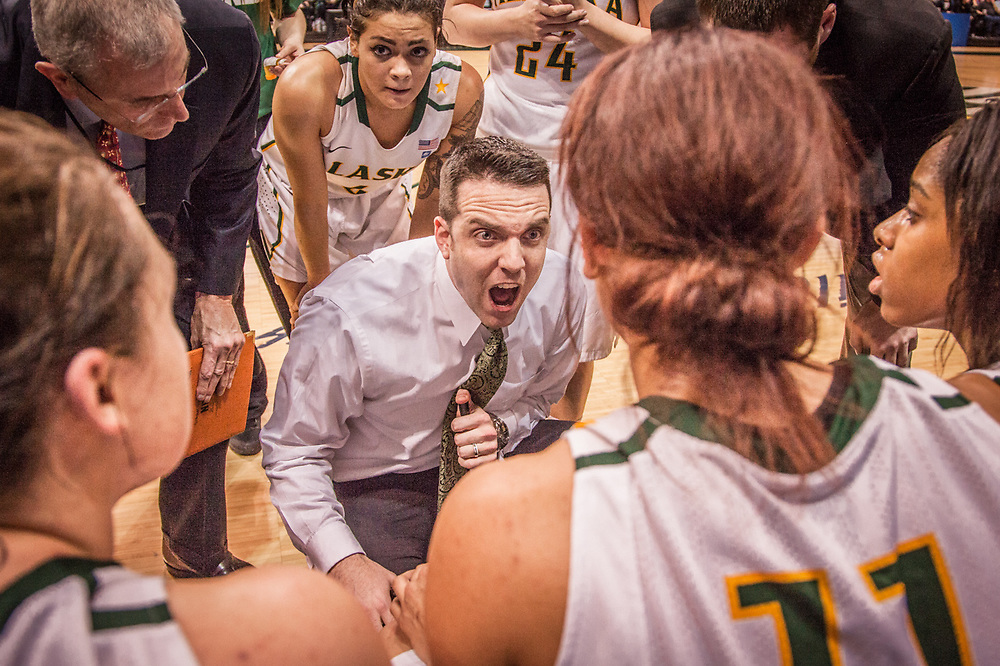 UAA Women Basketball coach Ryan McCarthy tries to rally his team in the final moments of the first game of the  Western Regional Championship at the Alaska Airlines Center in Anchorage.  UAA was upset by Point Loma of California 64-63.
