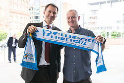 © Licensed to London News Pictures . 12/09/2017. Manchester , UK . Health Secretary JEREMY HUNT poses with a Dementia Friends scarf at the Health and Care Innovation Expo at Manchester Central Convention Centre . Photo credit: Joel Goodman/LNP