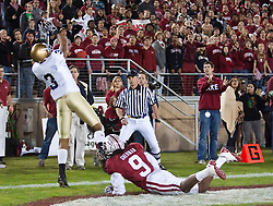 November 28, 2009; Stanford, CA, USA;  Notre Dame Fighting Irish wide receiver Michael Floyd (3) makes a touchdown catch in front of Stanford Cardinal cornerback Richard Sherman (9) during the first quarter at Stanford Stadium.  Stanford defeated Notre Dame 45-38.