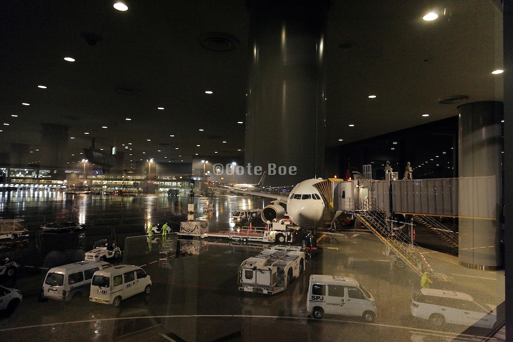airplane parked at the gate Narita airport Tokyo Japan