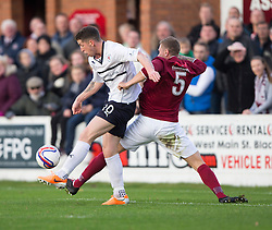 Raith Rovers Calum Elliot and Linlithgow Rose John Overstone.<br /> Half time : Linlithgow Rose 0 v 0 Raith Rovers, William Hill Scottish Cup Third Round game player today at Prestonfield.