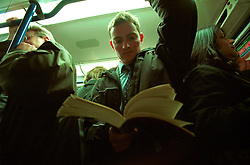 UK ENGLAND LONDON 13MAR02 - A commuters reads his book on an overcrowded London underground Picadilly Line train. ..The London Underground is a rapid transit system serving a large part of Greater London and neighbouring areas of Essex, Hertfordshire and Buckinghamshire in the UK. The Underground has 270 stations and about 400 km of track, making it the longest metro system in the world by route length; it also has one of the highest number of stations and transports over three million passengers daily...jre/Photo by Jiri Rezac..© Jiri Rezac 2002