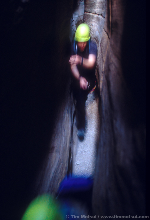 Garfield High students rush through the dark narrows of Baptist Draw, a canyon in the San Rafael Swell, Utah.