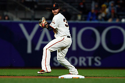 SAN FRANCISCO, CA - SEPTEMBER 24: Brandon Crawford #35 of the San Francisco Giants throws to first base against the San Diego Padres during the seventh inning at AT&T Park on September 24, 2018 in San Francisco, California. The San Diego Padres defeated the San Francisco Giants 5-0. (Photo by Jason O. Watson/Getty Images) *** Local Caption *** Brandon Crawford
