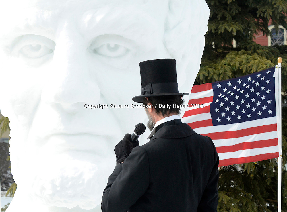 Laura Stoecker/lstoecker@dailyherald.com<br /> Last month, President Abraham Lincoln and Mary Todd Lincoln visited East Dundee's &quot;Love and Lincoln&quot; event to visit with residents and view a 10-foot snow bust dedicated to him in celebration of Lincoln's birthday and Valentine's Day. Lincoln's face is unforgettable and instantly recognizable, but so is his iconic black top hat. When Lincoln impersonator Michael Krebs of Chicago turned to face the sculpture during the dedication, I thought it made for a fun two-in-one sort of portrait and the reader would have no doubt of who the man was. Plus the flag added layer of history and a nice pop of color to the image.