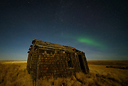 Once the sky became dark enough, a small patch of green aurora appeared in the northern sky. It was all that's left of the strong geomagnetic storm from the night before. This was the only picture I was able to get of this abandoned homestead before the aurora faded away.