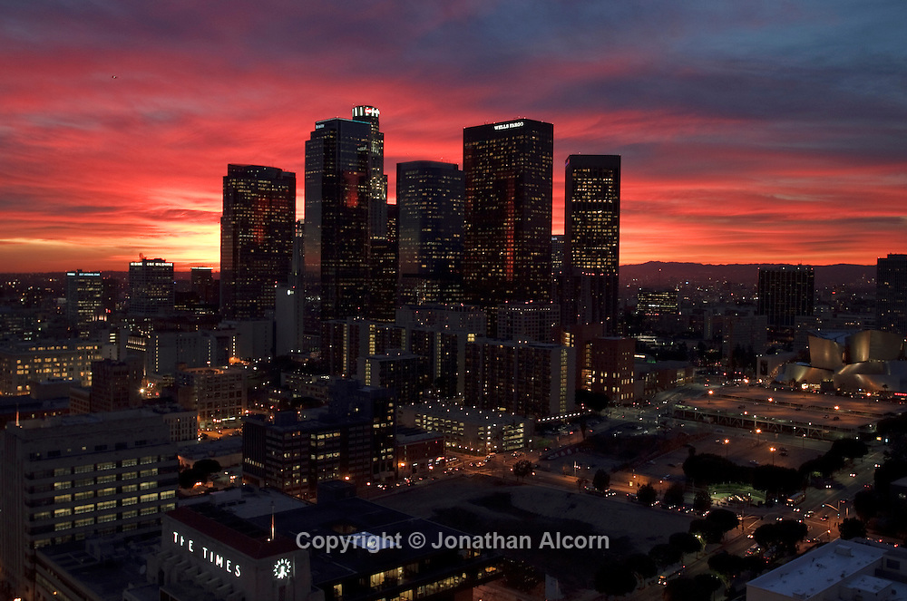 High clouds glow at dusk behind the downtown Los Angeles skyline as seen from an upper floor of City Hall on January 24, 2011