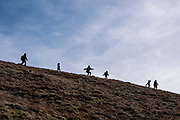Silhouette of children playing, walking and running along the mountainside of Pen Y Fan in Brecon Beacons National Park, Wales, Powys, United Kingdom, chased by an adult.  Pen Y Fan is the highest point in the Brecon Beacons hill and mountain range in South Wales. The National Park was established in 1957 due to the spectacular landscape which is rich in natural beauty and is run by the National Trust.  (photo by Andrew Aitchison / In pictures via Getty Images)