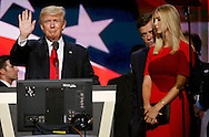 Republican presidential nominee Donald Trump waves as his campaign manager Paul Manafort (C) speaks with Trump daughter Ivanka (R) during Trump's walk through at the Republican National Convention in Cleveland July 21, 2016.  REUTERS/Rick Wilking