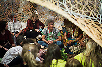 "VENICE, ITALY - 12 MAY 2017: Brazilian artist Ernesto Neto is seen here in tent, an installation in which Amazonian Huni Kuin people perform songs and ritual rites, at the Arsenale during  the 57th International Art Exhibition in Venice, Italy, on May 12th 2017.<br /> <br /> The 57th International Art Exhibition, titled VIVA ARTE VIVA and curated by Christine Macel, is organized by La Biennale di Venezia chaired by Paolo Baratta. ""Viva Arte Viva is an exclamation, a passionate outcry for art and the state of the artist. Viva Arte Viva is a Biennale designed with artists, by artists and for artists, about the forms they propose, the questions they ask, the practices they develop and the ways of life they choose"", Christine Macel says. <br />  <br /> Rather than broaching a single theme, Viva Arte Viva offers a route that moulds the artists' works and a context that favours access and understanding, generating connections, resonances and thoughts. VIVA ARTE VIVA will unfold over the course of nine chapters or families of artists, beginning with two introductory realms in the Central Pavilion, followed by another seven across the Arsenale through the Giardino delle Vergini. 120 are the invited artists from 51 countries; 103 of these are participating for the first time. <br /> <br /> The Exhibition will also include 85 National Participations in the historic Pavilions at the Giardini, at the Arsenale and in the historic city centre of Venice. 3 countries will be participating for the first time: Antigua and Barbuda, Kiribati, Nigeria."