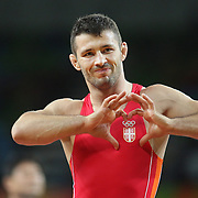 Wrestling - Olympics: Day 11   Davor Stepanek of Serbia, celebrates after defeating Shmagi Bolkvadze of Georgia <br /> in the Men's Greco-Roman 66 kg Semifinals contest during the wrestling tournament at the Carioca Arena 2 on August 16, 2016 in Rio de Janeiro, Brazil. (Photo by Tim Clayton/Corbis via Getty Images)