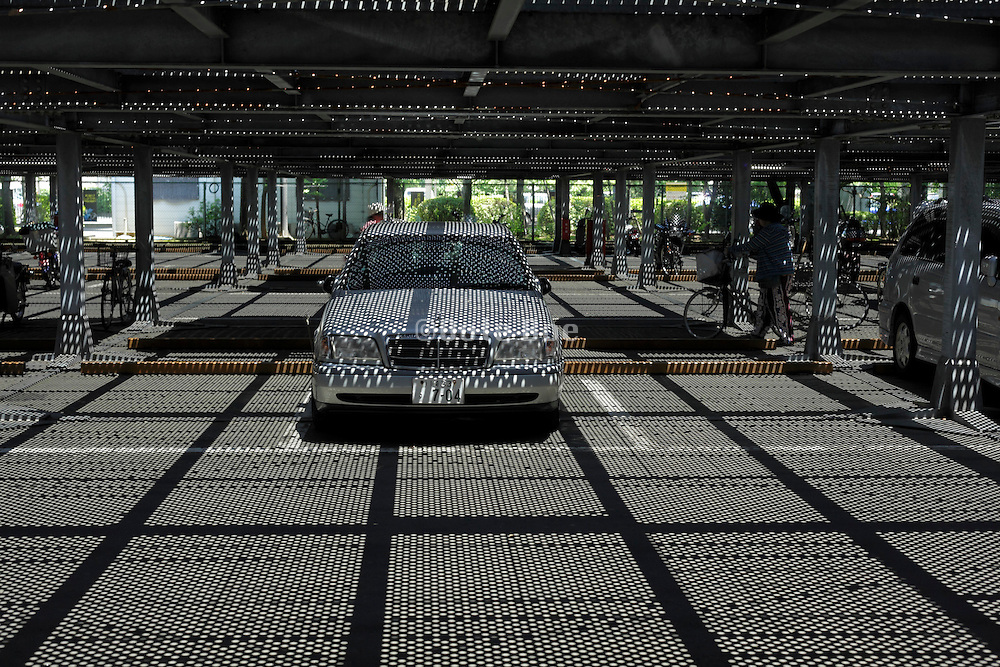 car park with overhead grating shadow projection