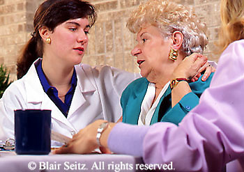 Medical Physical Therapy, Patient and Therapist, Caring Therapist Female Therapist Enjoys Patient Conversation,