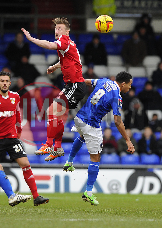 Bristol City's Wade Elliott battles for the ball with Oldham Athletic's Korey Smith - Photo mandatory by-line: Joe Meredith/JMP - Tel: Mobile: 07966 386802 08/02/2014 - SPORT - FOOTBALL - Oldham - Boundary Park - Oldham Athletic v Bristol City - Sky Bet League One