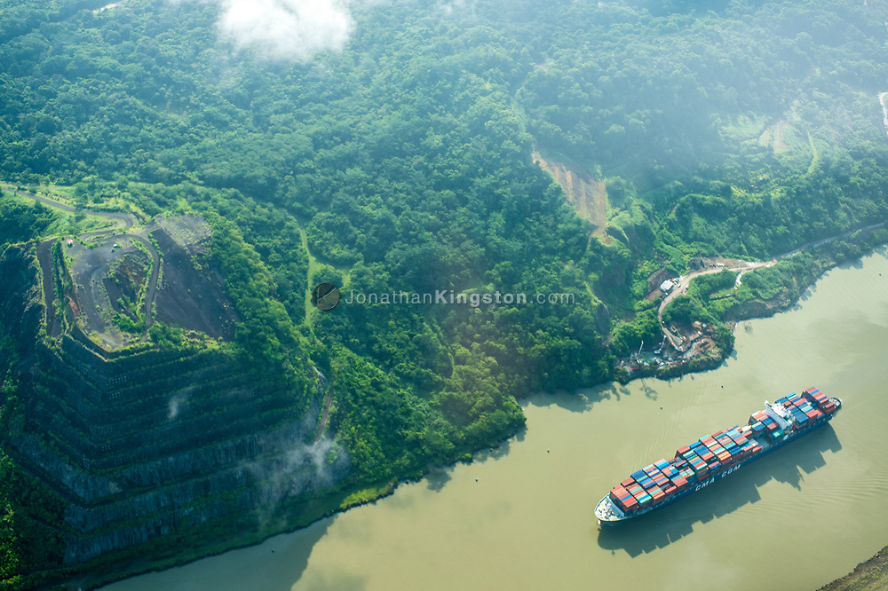 Aerial view of a large cargo ship transiting the Panama Canal, Panama.