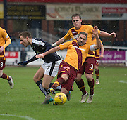 Motherwell&rsquo;s Keith Lasley tackles Dundee&rsquo;s Greg Stewart - Dundee v Motherwell, Ladbrokes Premiership at Dens Park <br /> <br />  - &copy; David Young - www.davidyoungphoto.co.uk - email: davidyoungphoto@gmail.com