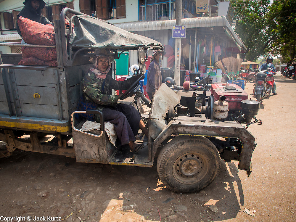 02 MARCH 2014 - MYAWADDY, KAYIN, MYANMAR (BURMA):  A home made truck drives through the market area in Myawaddy, Myanmar. Myawaddy is separated from the Thai border town of Mae Sot by the Moei River. Myawaddy is the most important trading point between Myanmar and Thailand.     PHOTO BY JACK KURTZ