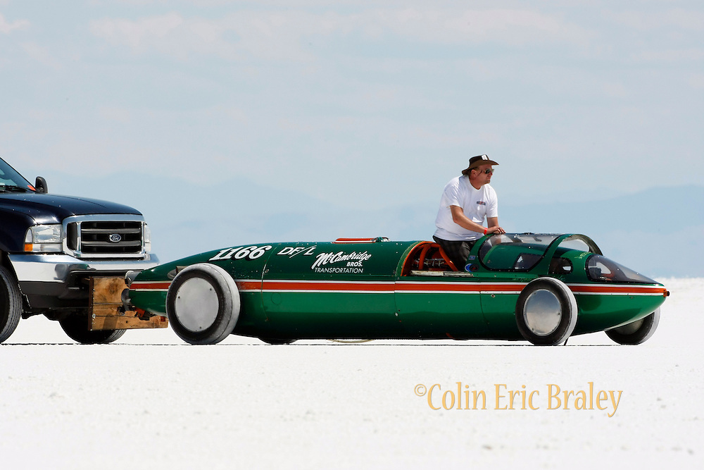 The best cars-people-atmosphere-photos of 2009 Bonneville Speed Week- The McCambridge Brother's Lakester, driven by Rick McCambridge of Napa, CA. is pushed to the start area at the Bonneville Speed Way. August 9, 2009.  Photo by Colin E. Braley