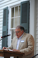 Oxford Mayor Pat Patterson reads The Reivers, written by Nobel Prize winning author William Faulkner, at the late writer's home of Rowan Oak in Oxford, Miss. on Friday, July 6, 2012. Faulkner died 50 years ago on July 6, 1962. Over 100 people are reading from the book to commemorate the occasion.