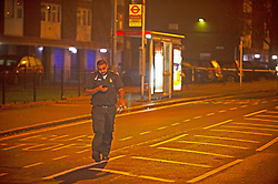© Licensed to London News Pictures. 24/12/2018. Bromley, UK.Paramedic walking back to ambulance,Christmas eve stabbing in Bromley,South East London tonight, victim is said to be in a serious condition. Police cordons in place at the scene. Photo credit: Grant Falvey/LNP