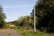 A passing airliner that passes overhead on a flight-path from Heathrow airport over footpath on Colne Valley Way.
