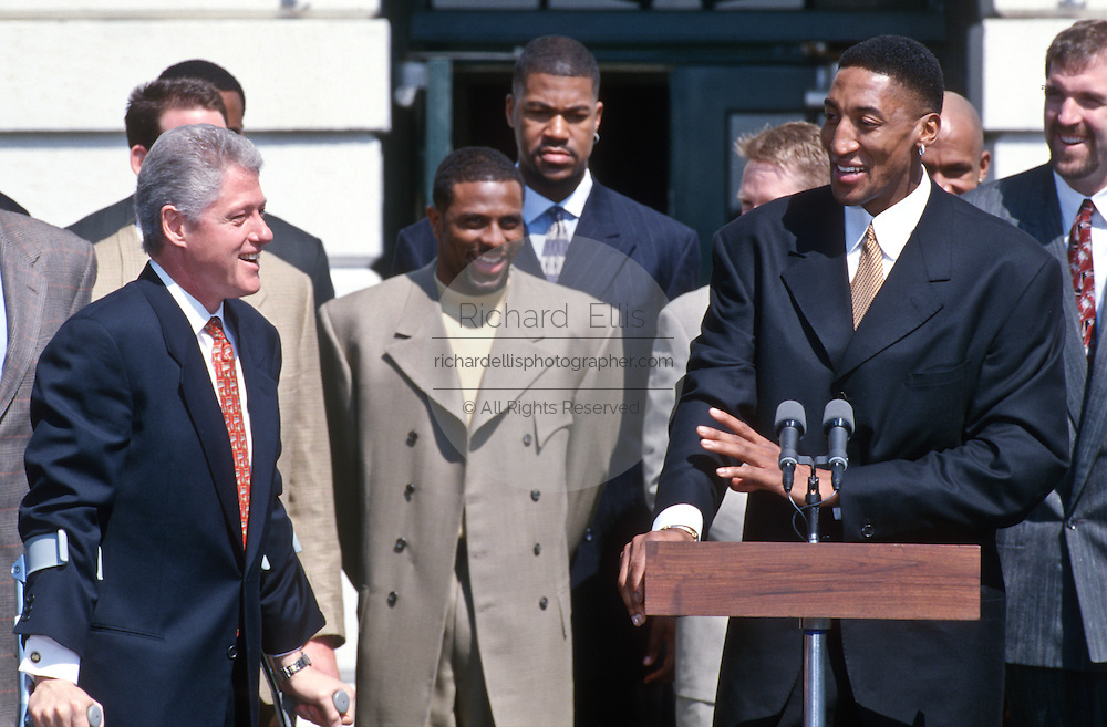 Chicago Bulls star Scottie Pippen thanks President Bill Clinton during an event on the South Lawn of the White House April 3, 1997. The event honored the NBA Champion Chicago Bulls.