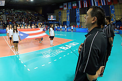 Puerto Rico coach Jose Mieles listens to Puerto Rico national anthem