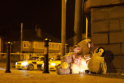 © Licensed to London News Pictures . 23/09/2012 . Salford , UK. Tributes left at the scene . Police close the East Lancs Road in Salford following a fatal RTA . The victim , a 14 year old boy , died after a collision with a car on the A580 between the Eccles Road and Worsley Road junctions . A 25 year old man has been arrested on suspicion of causing death by dangerous driving . Photo credit : Joel Goodman/LNP