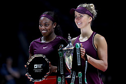 October 28, 2018 - Singapore - Elina Svitolina (right) of the Ukraine holds the Billie Jean King Trophy as she poses with runner up Sloane Stephens of the United States after winning the Singles Championship match on day 8 of the WTA Finals at the Singapore Indoor Stadium. (Credit Image: © Paul Miller/ZUMA Wire)