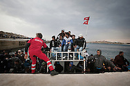 ITALY. Lampedusa:A boat of tunisian migrants arrive in  Lampedusa on  March  28, 2011. Copyright Christian Minelli.