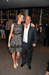 HEATHER KERZNER and SIR PHILIP GREEN at the launch of Samsung's NX Smart Camera at charity auction with David Bailey in aid of Marie Curie Cancer Care at the Bulgari Hotel, 171 Knightsbridge, London on 14th May 2013.