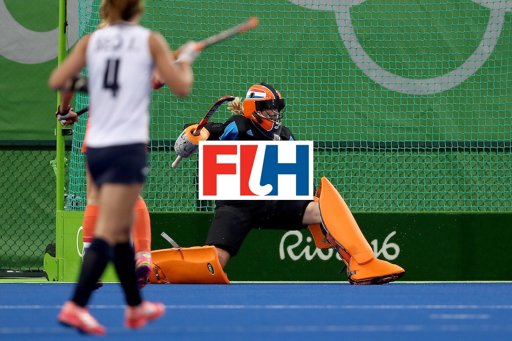 RIO DE JANEIRO, BRAZIL - AUGUST 08:  Joyce Sombroek #1 of Netherlands blocks a shot on goal against Korea during a Women's Pool A match on Day 3 of the Rio 2016 Olympic Games at the Olympic Hockey Centre on August 8, 2016 in Rio de Janeiro, Brazil.  (Photo by Sean M. Haffey/Getty Images)