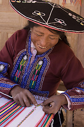 Woman weaving on backstrap loom, Raqchi (near Cuzco), Peru, South America.  MR