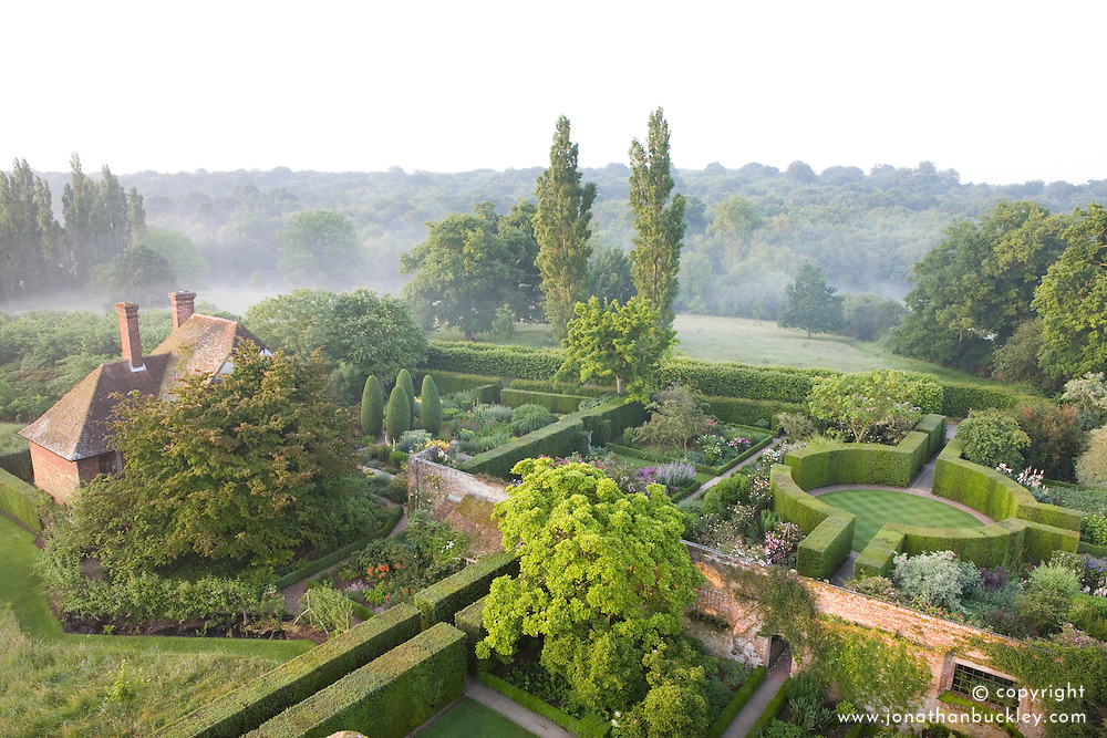 The South Cottage and Rose Garden with roundel seen from the Tower at Sissinghurst Castle Garden at dawn