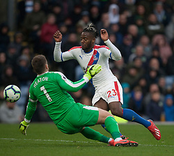 Michy Batshuayi of Crystal Palace (R) takes the ball around Thomas Heaton of Burnley - Mandatory by-line: Jack Phillips/JMP - 02/03/2019 - FOOTBALL - Turf Moor - Burnley, England - Burnley v Crystal Palace - English Premier League