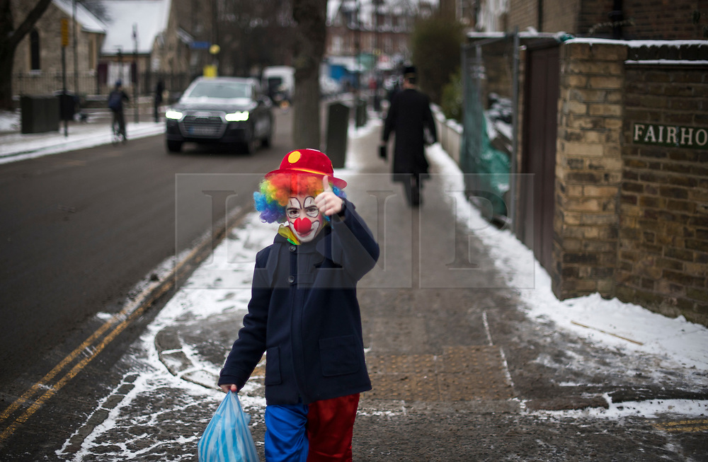 © Licensed to London News Pictures. 01/03/2018. London, UK. An orthodox Jewish child in fancy dress celebrates the festival of Purim on the streets of Stamford Hill in north London on March 1, 2018. Purim celebrates the miraculous salvation of the Jews from a genocidal plot in ancient Persia, an event documented in the Book of Esther. Traditionally the jewish community wear fancy dress and exchange reciprocal gifts of food and drink. Photo credit: Ben Cawthra/LNP