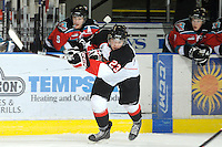 KELOWNA, CANADA, OCTOBER 26: Austin Daae #23 of the Prince George Cougars takes a shot on Kelowna Rockets net as Prince George Cougars visit the Kelowna Rockets  on October 26, 2011 at Prospera Place in Kelowna, British Columbia, Canada (Photo by Marissa Baecker/Shoot the Breeze) *** Local Caption ***Austin Daae;