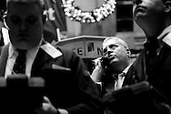 Traders work on the floor of the New York Stock Exchange in New York, U.S., at the start of the trading day on Monday, Dec. 8, 2008. U.S. stocks rallied for a second day after President-elect Barack Obama pledged the largest public works-spending package since the 1950s and lawmakers worked to reach an agreement to rescue the auto industry. Photo by Keith Bedford