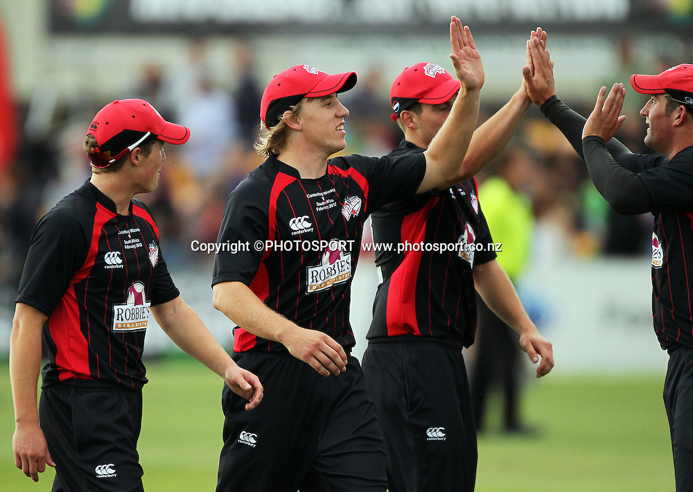 Logan van Beek high fives with Canterbury team mates. Canterbury Wizards v South Africa. International Twenty20 cricket match, Hagley Oval, Wednesday 15 February 2012. Photo : Joseph Johnson / photosport.co.nz
