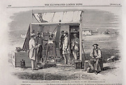 The Kew heliograph being used during the British astronomical expedition to view the total solar eclipse, Spain, 1860. The temporary observation point with the Kew heliograph inside, surrounded by astronomers. Warren De La Rue took the first photographs of a total eclipse on this expedition. From 'The Illustrated London News' Vol 37 (London, 1860).