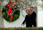 U.S President Bill Clinton and first lady Hillary Rodham Clinton walk past a Christmas wreath after attending a gathering of Democratic leaders outside the White House following his impeachment December 19, 1998 in Washington, DC.  The US House of Representatives impeached Clinton on charges of perjury and obstruction of justice. Clinton rejected calls for his resignation and vowed to continue in office.