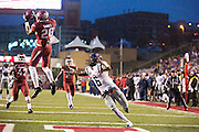FAYETTEVILLE, AR - NOVEMBER 22:  Rohan Raines #26 of the Arkansas Razorbacks intercepts a pass in front of Jaylen Walton #6 of the Ole Miss Rebels that he returns 100 yards for a touchdown at Razorback Stadium on November 22, 2014 in Fayetteville, Arkansas. The Razorbacks defeated the Rebels 30-0.   (Photo by Wesley Hitt/Getty Images) *** Local Caption *** Rohan Gaines; Jaylen Walton