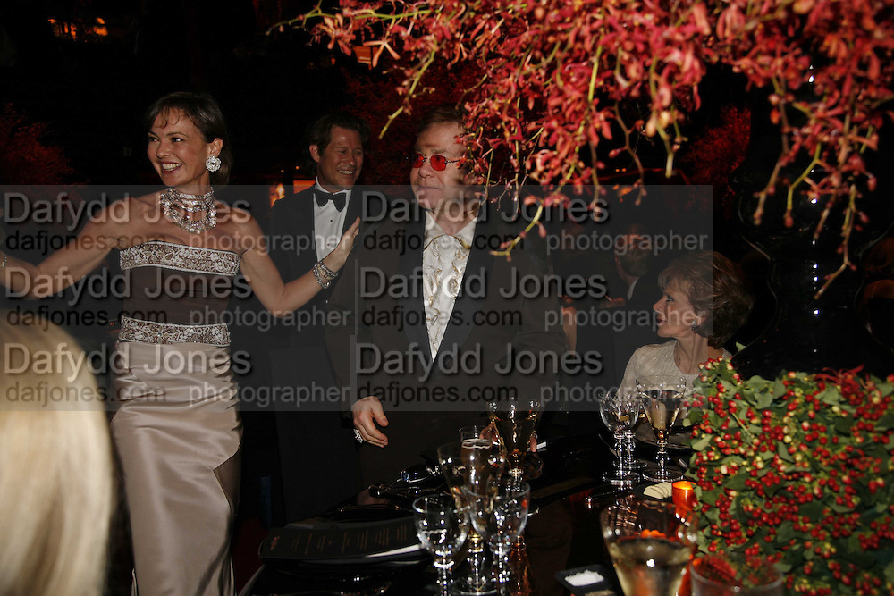Countess Maya von Schonburg, Sir Elton John and Lily Safra, Ark Gala Dinner, Marlborough House, London. 5 May 2006. ONE TIME USE ONLY - DO NOT ARCHIVE  © Copyright Photograph by Dafydd Jones 66 Stockwell Park Rd. London SW9 0DA Tel 020 7733 0108 www.dafjones.com