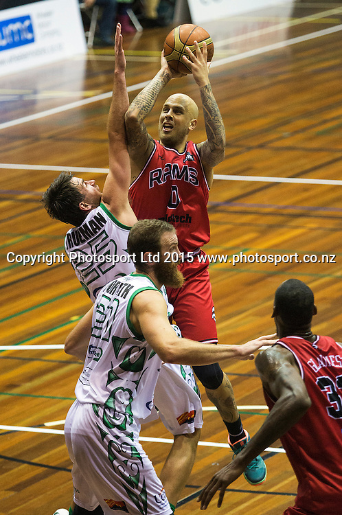 Richie Edwards of the Rams takes a shot over Jeremiah Trueman of the Jets during the National Basketball League game between the Canterbury Rams v Manawatu Jets at Cowles Stadium in Christchurch. 10th April 2015 Photo: Joseph Johnson/www.photosport.co.nz