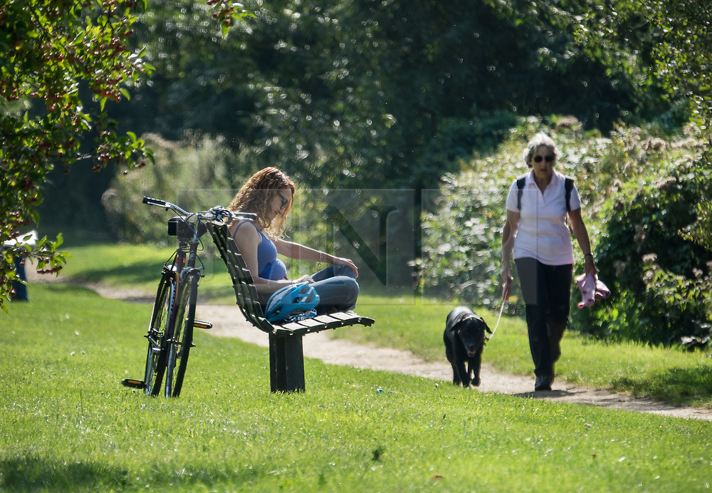 © Licensed to London News Pictures. 02/09/2017. Hampton Court, UK. People enjoy the sunshine next to the River Thames near Hampton Court. A period of warmer weather is predicted over the next few days after the recent wet spell. Photo credit: Peter Macdiarmid/LNP
