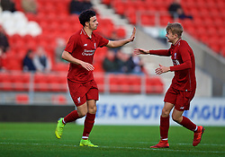 ST HELENS, ENGLAND - Monday, December 10, 2018: Liverpool's Curtis Jones celebrates scoring the fourth goal with team-mate Jake Cain (R) during the UEFA Youth League Group C match between Liverpool FC and SSC Napoli at Langtree Park. (Pic by David Rawcliffe/Propaganda)