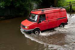 © Licensed to London News Pictures 6/7/2012. Birmingham, UK. A van crawls through the floods in Green Lane, Moseley, Birmingham. Photo credit : Dave Warren/LNP