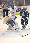 Michigan State's Adam Henderson (right) and Lake Superior State's Kyle Haines (rear) watch as the puck goes into the net after LSSU goalie Pat Inglis (30) gets caught out of position after a face off.  The goal was the Spartans second and final goal during their 4 to 2 loss in Sault Ste. Marie.