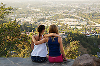 Two friends overlooking the San Fernando Valley from a lookout on Mulholland Drive in Los Angeles.